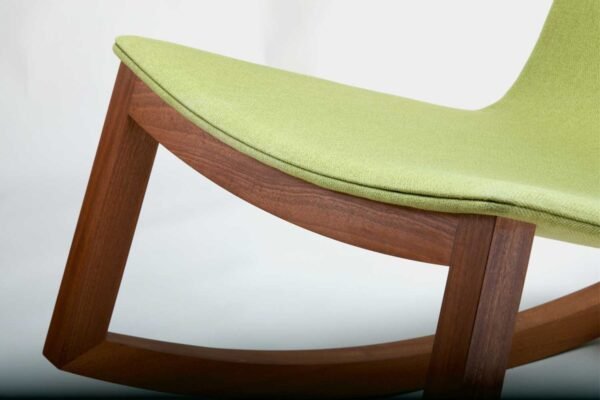 Modern rocking chair, with green fabric and mahogany frame