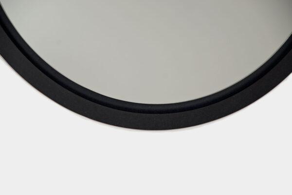 Round, black mirror detail