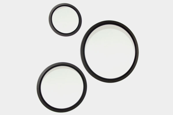 Set of large, round, black mirrors