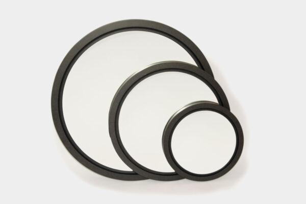 Modern, large round black mirror