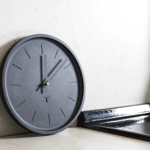 Round, black wall clock, made in Ireland