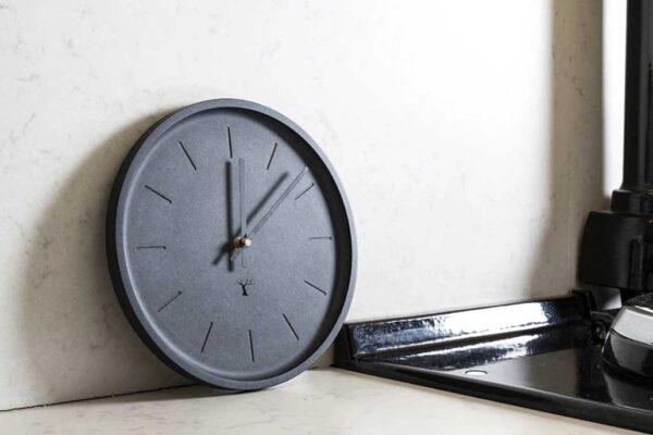 Round, black wall clock, made in Ireland