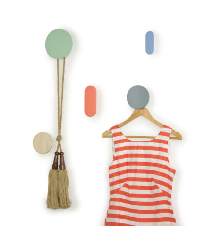 Decorative WRAP coat hooks, ideal for modern homes and kids bedrooms. Individual wall hooks and rocking chair located in a kids nursery room and modern living room