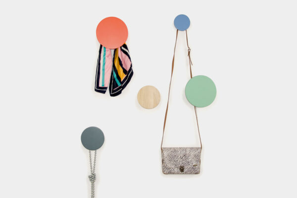 Modern coat hooks, bringing a splash of colour to the wall