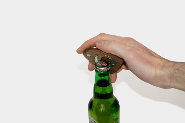 Opening a bottle with a modern Irish made bottle opener