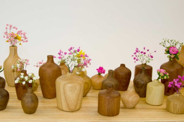 Group of colourful flower vases, made local fom Irish wood