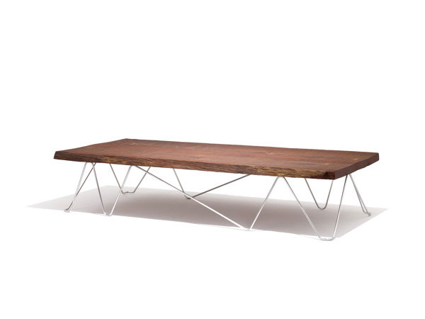 Modern dining table with steel legs, made from Irish wood